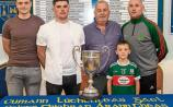 Carrick Swans and Mullinahone captains