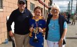 Cashel grandparents present cup to camogie blitz captain Ella