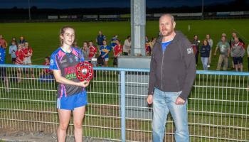 Templemore Captain Ava Ormond with the John Kennedy Motors Division 1 trophy pictured Chairman Lar Roche  Tipperary LGFA