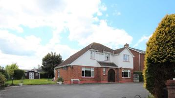 Outstanding four-bedroom family home with a private garden, in one of Clonmel's premier residential areas