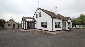 An executive 4 bed Large family home on a good site with extensive outbuildings at Rathmore, Cahir