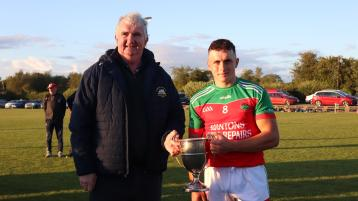 Michael Ryan C, Chairman of the West Board presented the Crosco Cup to Cashel King Cormac captain Conn Bonnar